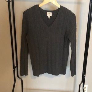 Medium gray sweater.